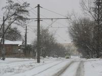Переулок Галины Петровой, трамвайный пути. На фоне - ЮРГТУ (НПИ)