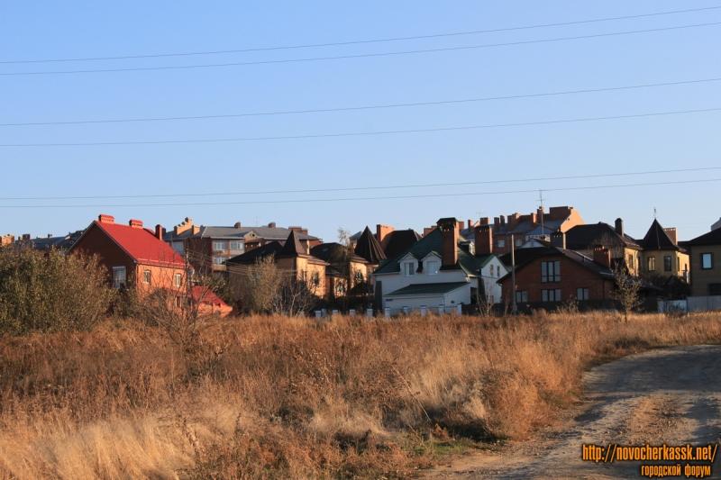 Дома на Буденновской между Багряным и Вешенским переулком