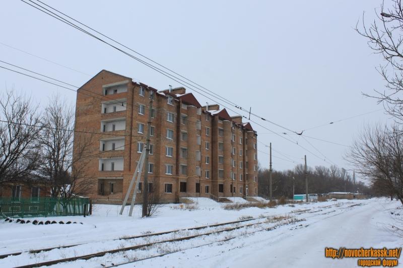 Многоэтажка на углу Калинина и Гвардейской
