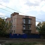 Строительство трехэтажного дома на улице Александровской