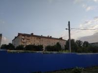 Площадка строительства дома. На фоне -  пр. Баклановский, 188